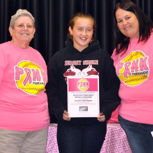 Tara, right, poses with Komen CSNJ Volunteer & Breast Cancer Survivor, Della Porter and a 2014 U-12 top fundraiser.