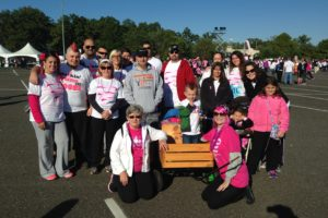 Fawn Biosca-Planas, kneeing in pink shirt, is pictured with her team at the Komen CSNJ Race for the Cure in 2014, the last she was able to participate in before she lost her battle with the disease.